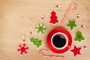 Coffee cup and christmas decor on wooden background