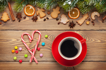 Coffee cup and christmas food decor on wooden background
