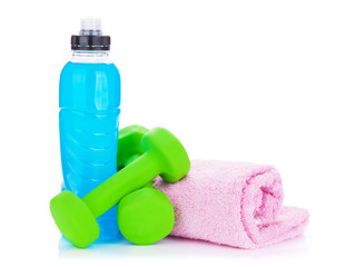 Two green dumbells, drink bottle and towel