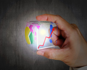 hand holding glowing colorful transparent glass cubic