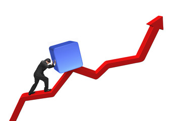 businessman pushing blue 3D cube upward on red trend line