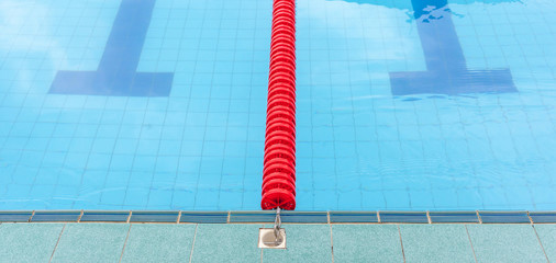 The red marked lane in center of platform for swimming competiti