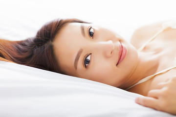 young Beautiful woman relaxing on the bed