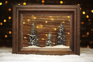 Peaceful winter scene in frame with trees and snow