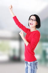 Excited woman with fists up