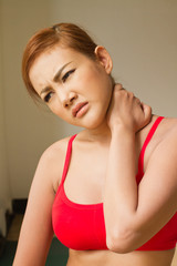 woman suffering from neck pain, injury