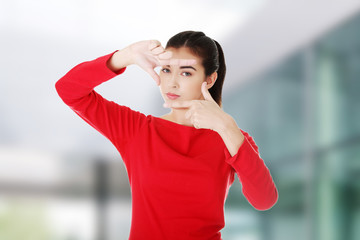 Woman gesturing frame sign