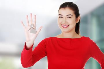Caucasian woman holds keys