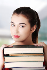 Woman with stack of books