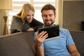 Couple relaxing at home with the internet