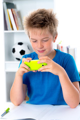 boy is using his smartphone
