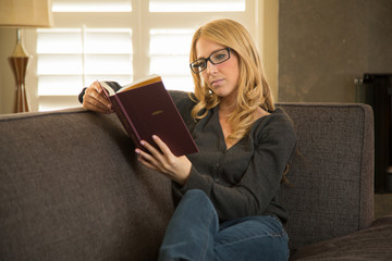 Caucasian woman reading a novel