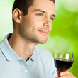 Portrait of man with glass of redwine