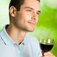 Portrait of man with glass of redwine