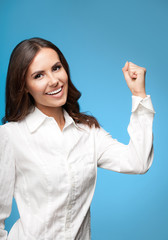 Happy gesturing businesswoman, against blue
