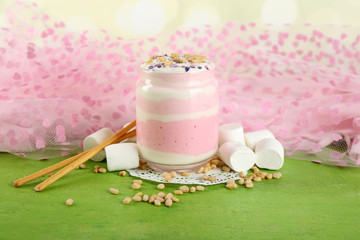 Cranberry milk dessert in glass jar,