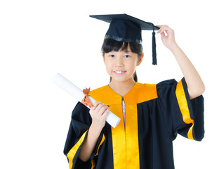 Asian school kid in graduation gown