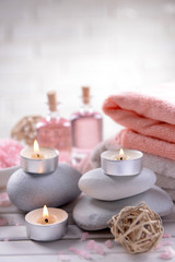 Composition of spa treatment on table on white background