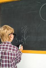 Schoolboy and blackboard