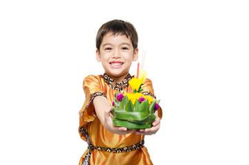 Little boy taking krathong in Loy Krathong floating festival