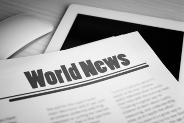 On-line news concept. Computer mouse, PC tablet and newspaper,