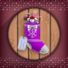 Christmas sock with gifts suspended on the wooden circle board