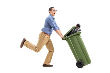 An excited man pushing a garbage can