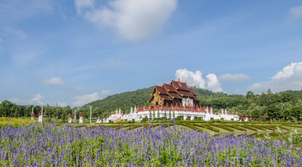 Beautiful view of Thai Lanna architecture with flower garden in