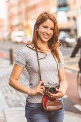 Cheerful photographer standing outside smiling at camera