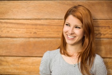 Pretty redhead smiling and thinking