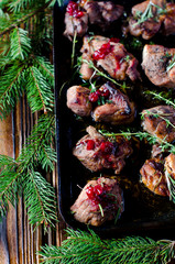 Baked meat with cranberry sauce