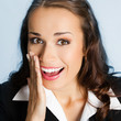 Business woman covering mouth, over blue