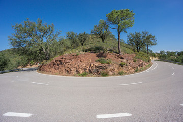 Worms eye view of mountain hairpin bend curved road