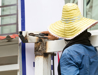 Man work steel pillar welding.