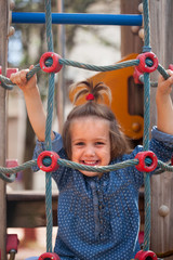girl at action-oriented playground