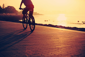 cycling at sunrise seaside