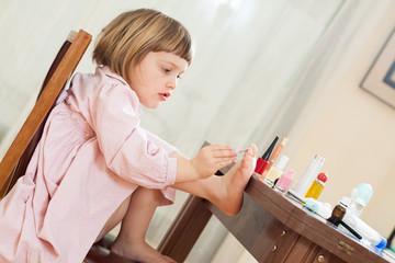 Little  girl making pedicure