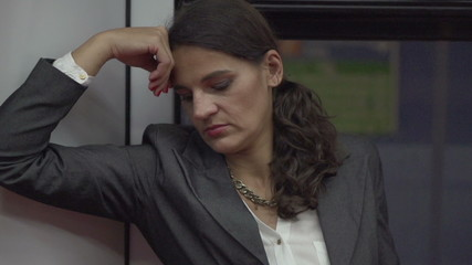 Unhappy businesswoman riding on subway, slow motion, steadycam