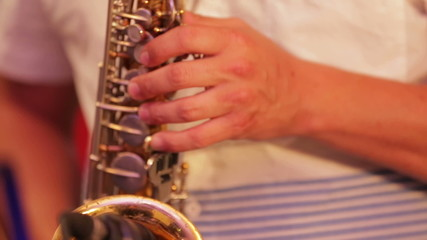 Musician Plays Saxophone. Close-up