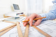 canvas print picture - Close up view of an architect working at office