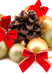 Christmas golden balls with red ribbons on a white background