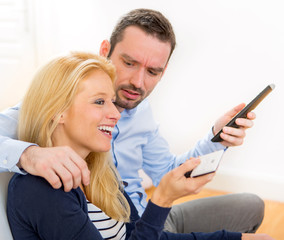 Young attractive couple discording watching tv