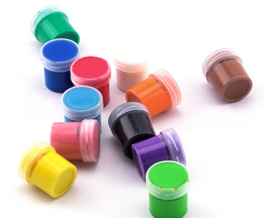 jars with colored paint on a white background