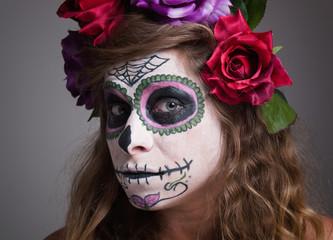 Halloween witch. Beautiful woman wearing santa muerte mask portr