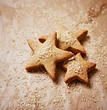 Gingerbread stars dusted with brown sugar