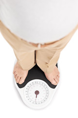 Shot of a man standing on a weight scale