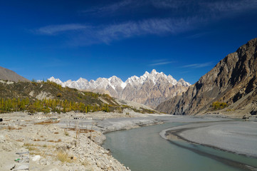Tupopdan peaks and small river in Northern  Pakistan.