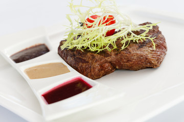 steak with sauces