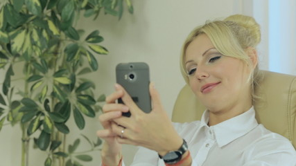 Beautiful girl doing selfie on phone