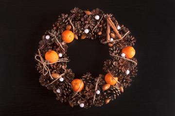 Citrus Christmas Wreath. On black pine wood.